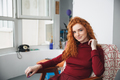 Portrait of a beautiful young redheaded woman