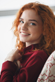 Close up portrait of a smiling young redheaded woman