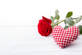 Red rose and a heart on white background