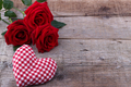 Hearts and a bouquet of red roses on wooden board, Valentines Da