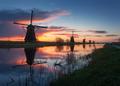 Silhouette of windmills at sunrise in Kinderdijk, Netherlands