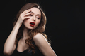 Seductive attractive young woman with red lips standing and posing