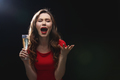 Sad disappointed young woman holding glass of champagne and screaming