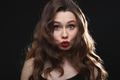 Pretty funny young woman with red lips making duck face