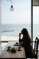 Girl sitting in cafe
