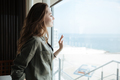 Woman looking in window