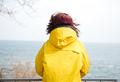 Photo of thinking woman near sea