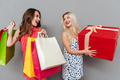 Amazing young two ladies friends with shopping bags