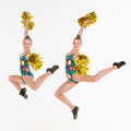The two of teen cheerleaders jumping at white studio