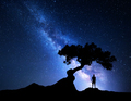 Blue milky way tree and man