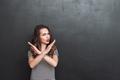 Displeased woman showing stop gesture