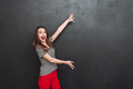 Happy woman demonstrates something