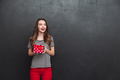 Smiling woman holding gift box