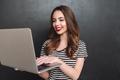 Smiling woman using laptop computer