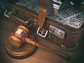 Gavel and suitacse full of money. Concept of corruption, busines