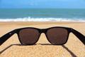 Black sunglasses on the beach