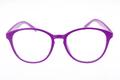 Purple eyeglasses isolated on white