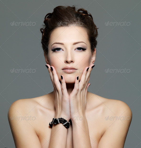 glamour sexy young  female with black nails - Stock Photo - Images