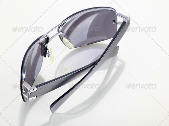 Cut out of Female Sunglasses on white background - Stock Photo - Images