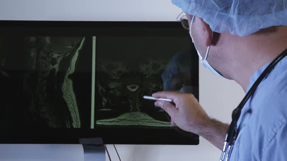 Download Doctor Checking X-ray Photo Of A Patient 06 nulled download