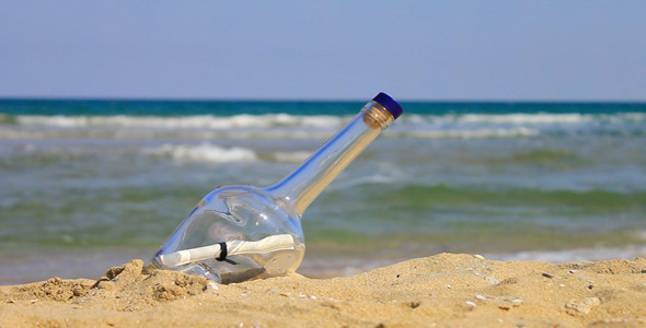 Letter In A Bottle On The Beach