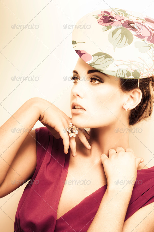 woman wearing v-neck blouse and floral hat - Stock Photo - Images