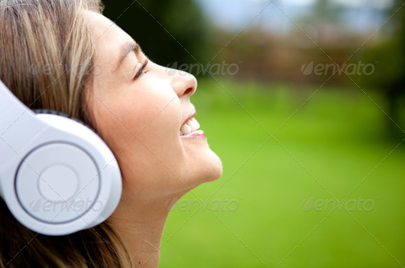 Happy woman listening to music - Stock Photo - Images