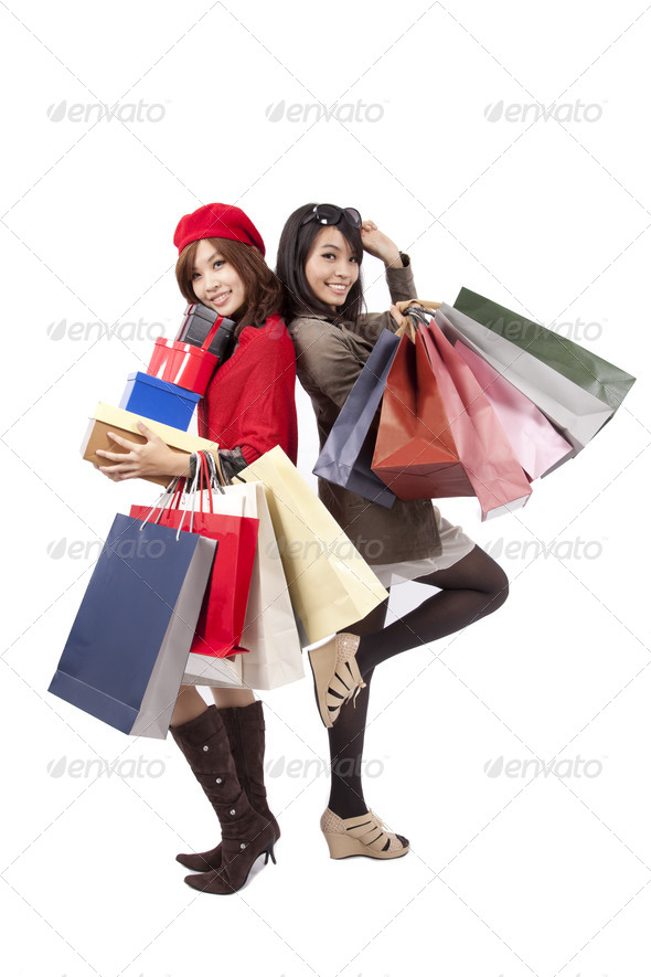 Two happy shopping  beautiful girls with the bags - Stock Photo - Images