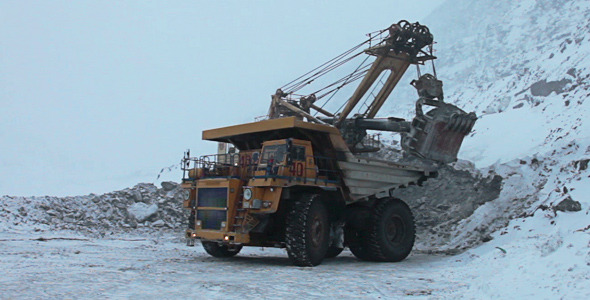 Dump Truck Loaded With An Excavator