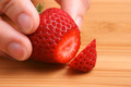 Holding a Fresh Cut Strawberry  - PhotoDune Item for Sale
