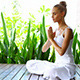Woman Practicing Yoga And Meditating - VideoHive Item for Sale