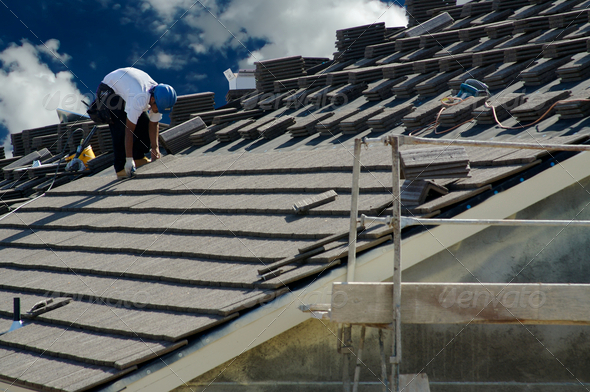 Stock Photo - PhotoDune Roofer Laying Tile 270332