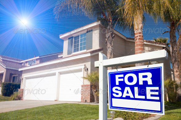 Blue For Sale Real Estate Sign and House - Stock Photo - Images