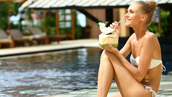 VideoHive Beautiful Girl at the Edge of Swimming Pool 2409671