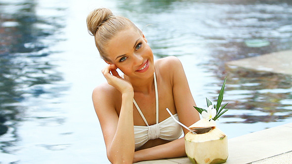 VideoHive Adorable blond woman standing in swimming pool and 2409678