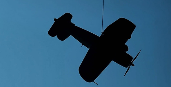 Small Airplane Rotates On A String 1