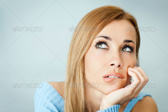 pensive woman biting lips - Stock Photo - Images