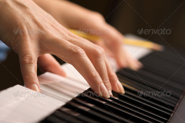 Woman's Fingers on Digital Piano Keys - Stock Photo - Images