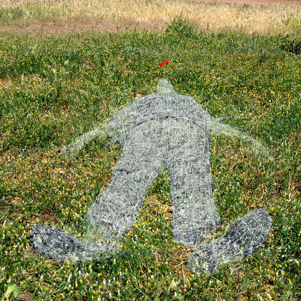 human figure imprinted on grass - Stock Photo - Images