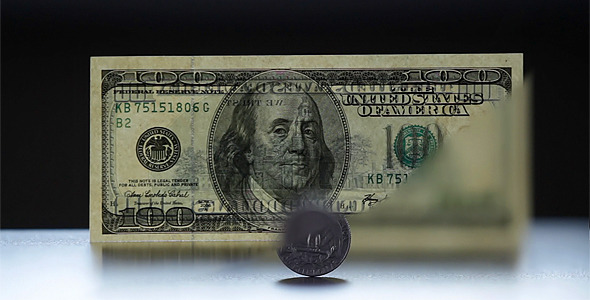 Coin And 100 Dollar Bill