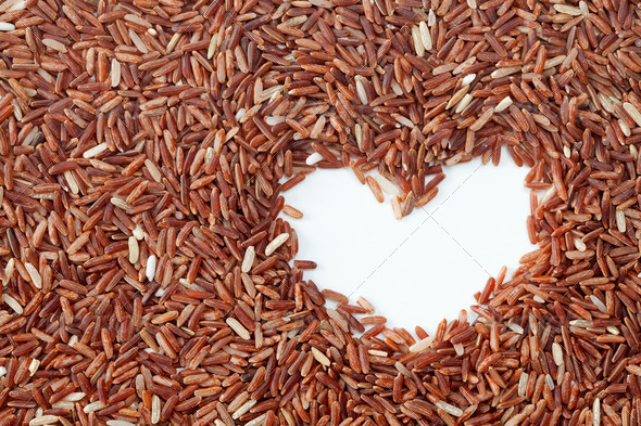 Brown rice with heart shape - Stock Photo - Images