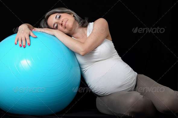 Pregnant woman and gym ball - Stock Photo - Images