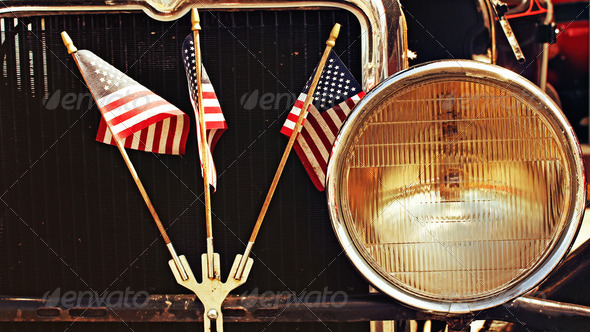 American Flags on Antique Car - Stock Photo - Images