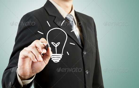 business man drawing light bulb idea - Stock Photo - Images