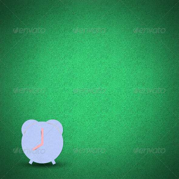 Clock green grass background - Stock Photo - Images