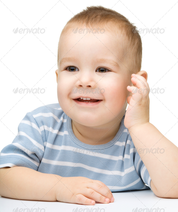 Portrait of a cute and pensive little boy - Stock Photo - Images