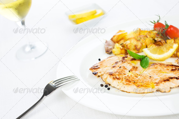 Chicken breast grilled with potatoes, tomatoes and spices - Stock Photo - Images