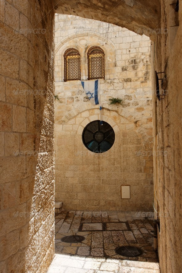 Arched passage in the Old City of Jerusalem with Israeli flag - Stock Photo - Images