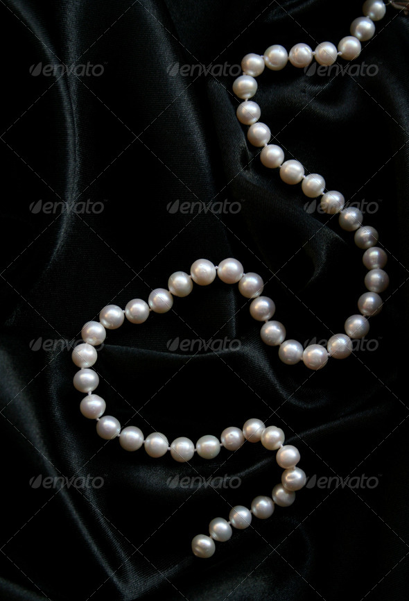 White pearls on the black velvet - Stock Photo - Images