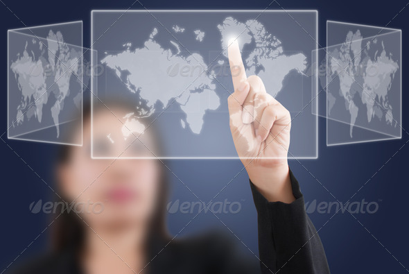 Business Lady pushing world map button. - Stock Photo - Images